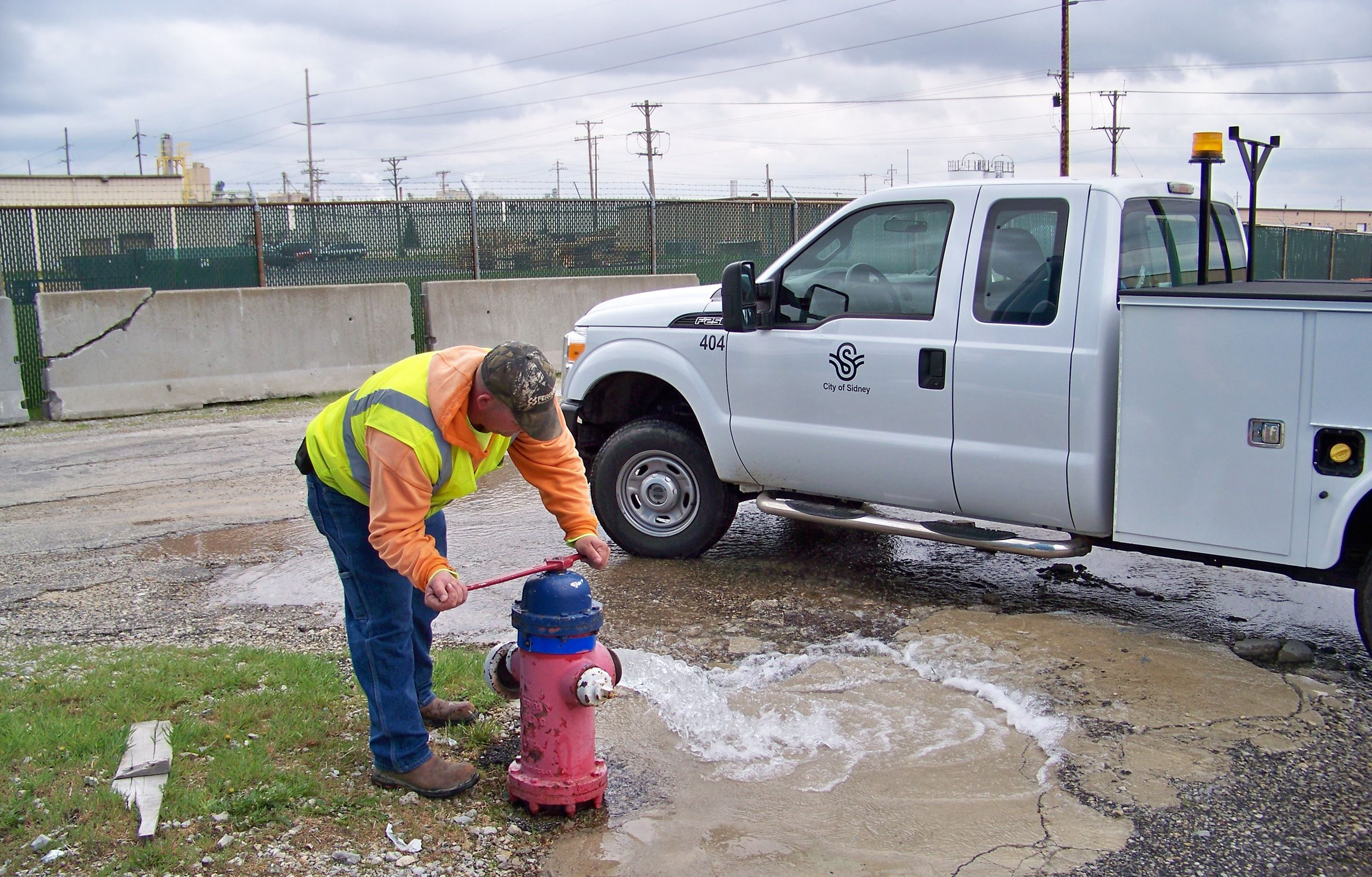 City of Sidney employee testing fire hydrant