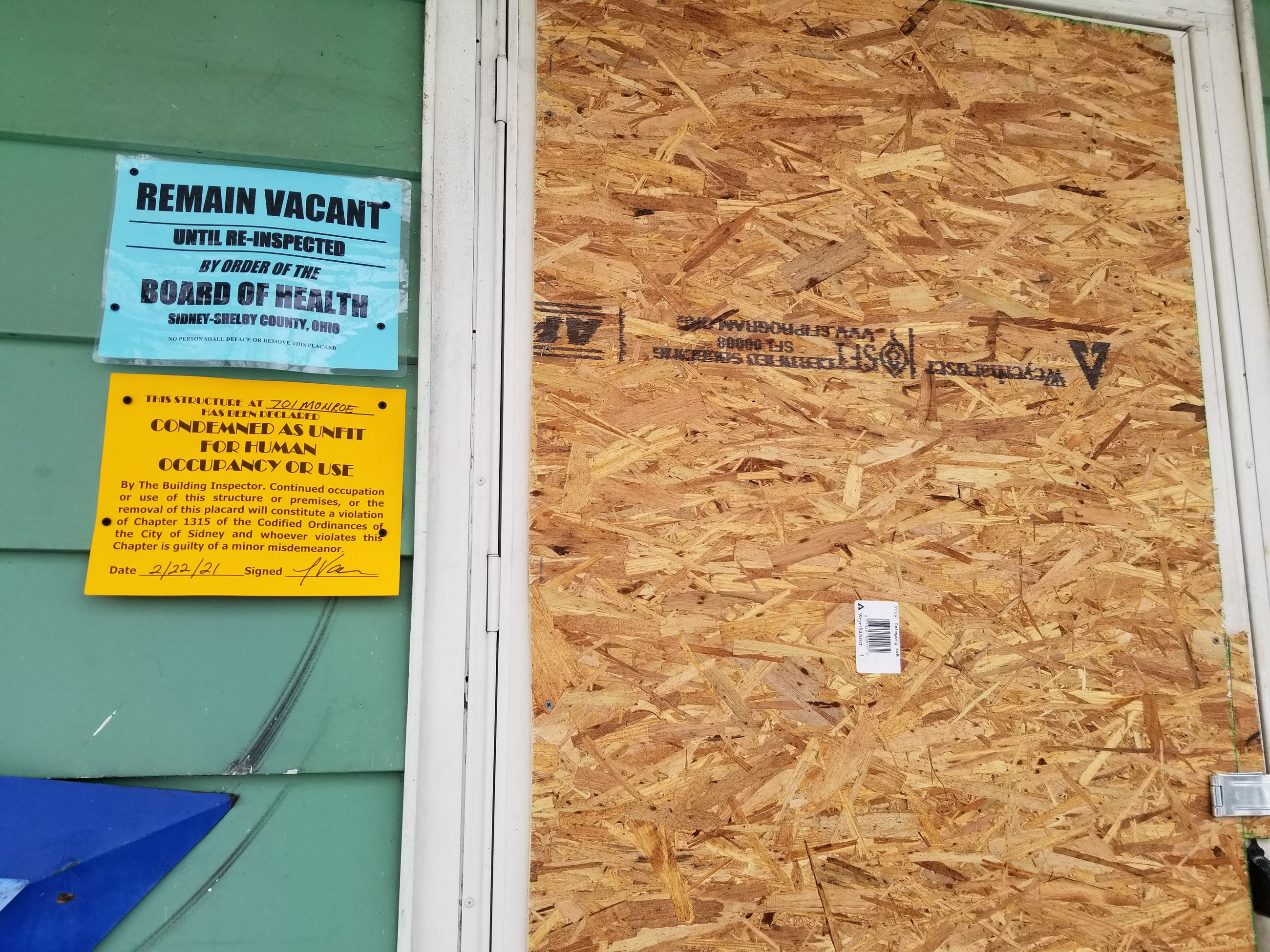Remain Vacant and Condemned as Unfit for Human Occupancy or Use Placards at 701 Monroe Street, Sidne