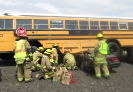 Firefighters Fixing a School Bus